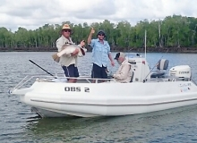 Guide Jason Hill gives the thumbs up for Don Russell with his 108cm barra.